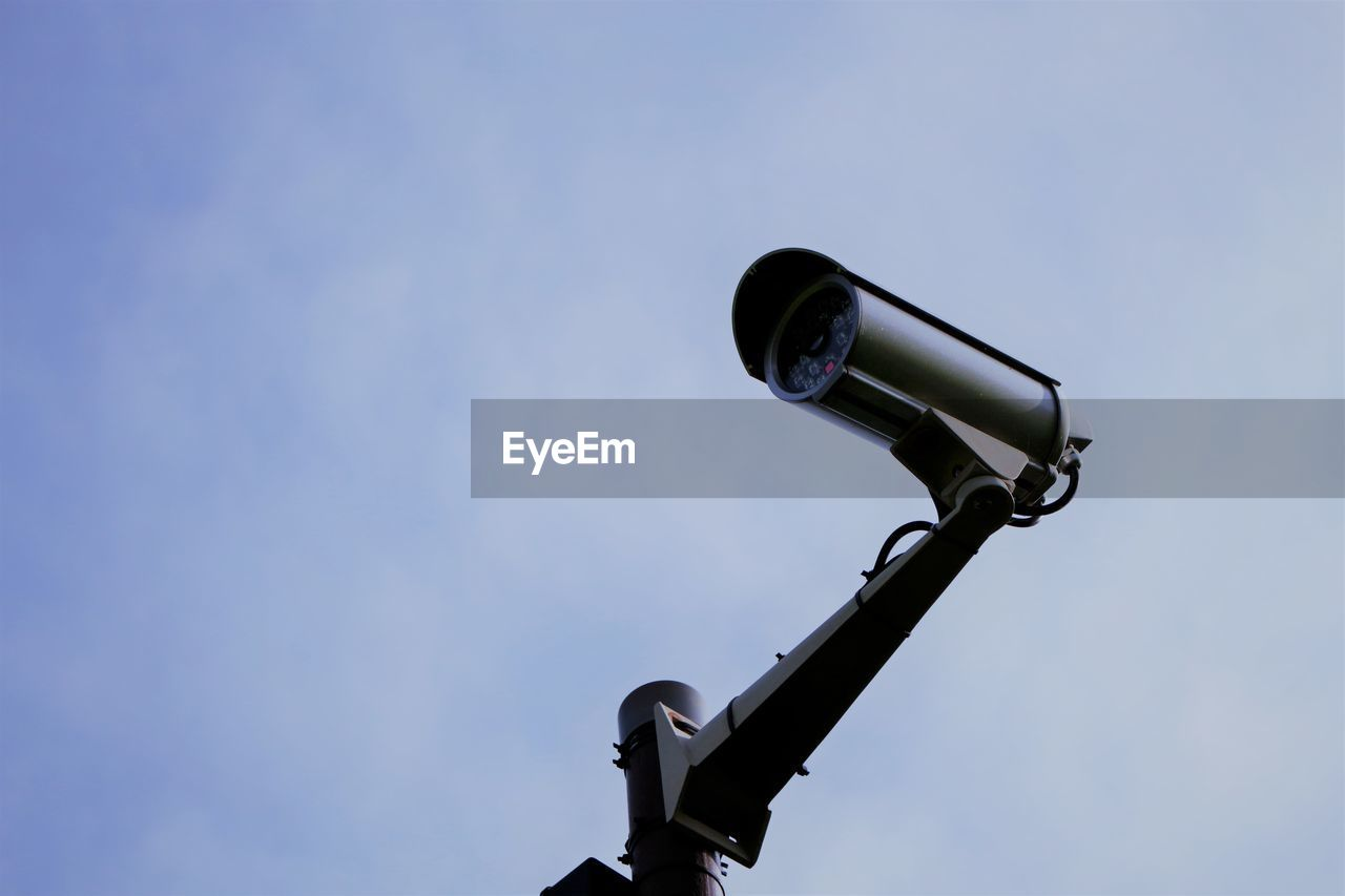 surveillance, sky, security, protection, optical instrument, technology, safety, scrutiny, security system, day, blue, no people, security camera, nature, clear sky, low angle view, outdoors, copy space, watching, binoculars, home video camera, hand-held telescope, big brother - orwellian concept