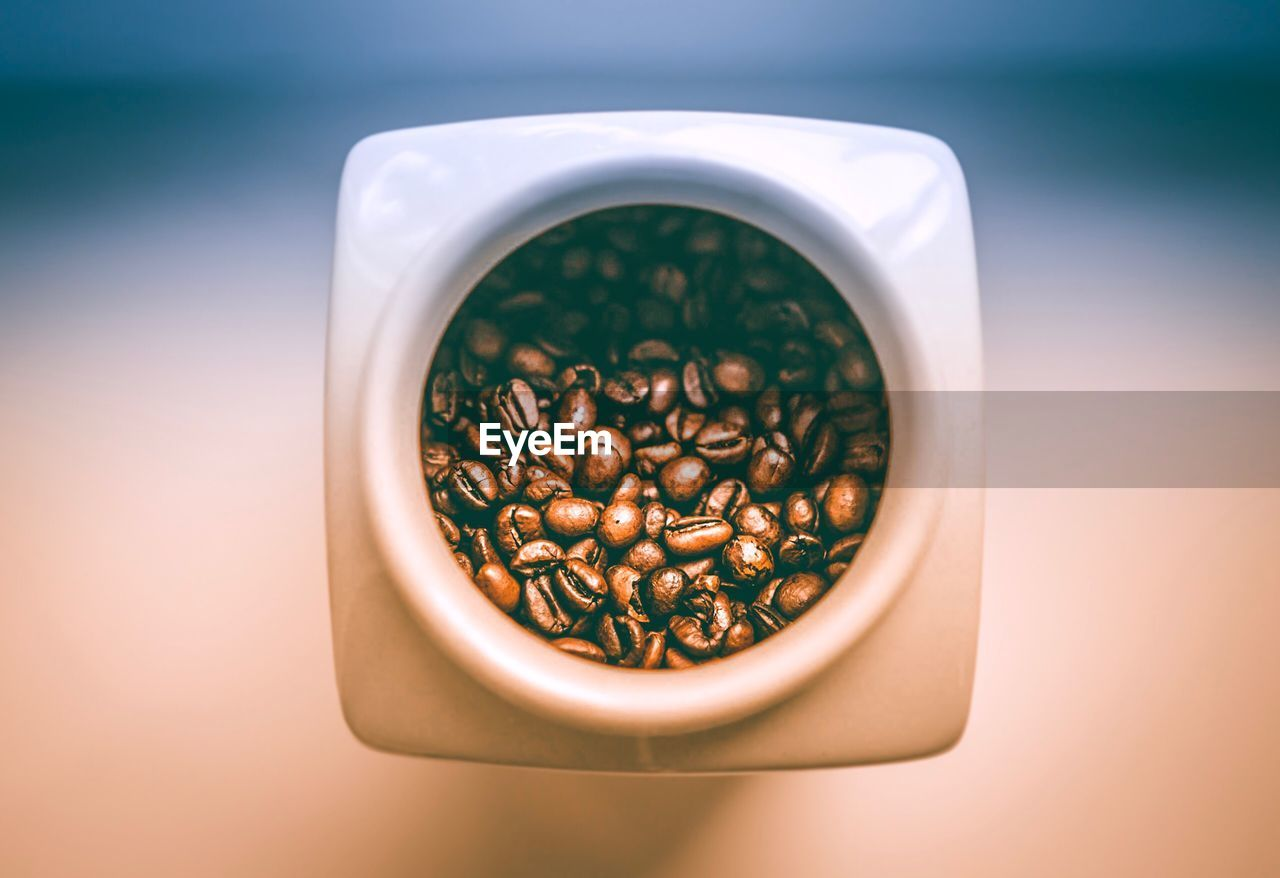 Directly Above Shot Of Roasted Coffee Beans In Container