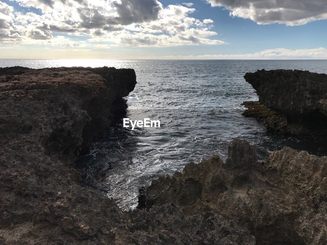 sea, water, nature, rock - object, beauty in nature, rock formation, scenics, horizon over water, sky, tranquility, tranquil scene, rock, no people, cloud - sky, outdoors, cliff, day, beach, wave