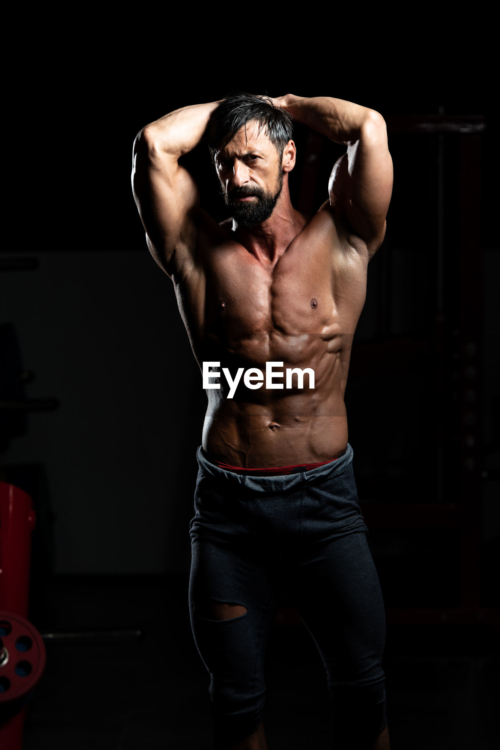 MIDSECTION OF SHIRTLESS MAN WEARING SUNGLASSES