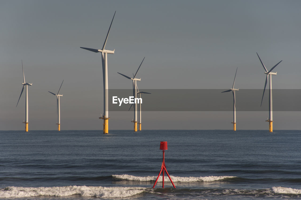 renewable energy, sky, fuel and power generation, wind turbine, turbine, alternative energy, environmental conservation, wind power, environment, water, sea, beauty in nature, nature, technology, horizon, no people, scenics - nature, horizon over water, day, outdoors, sustainable resources