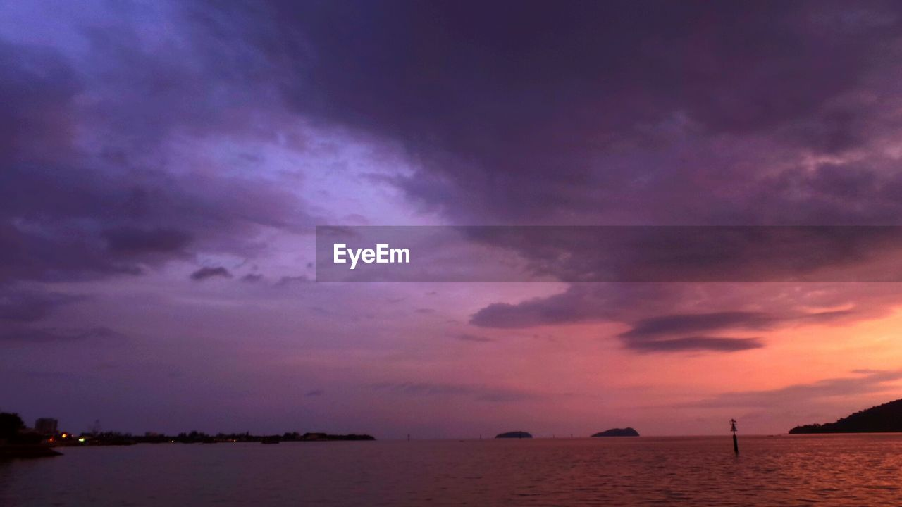 Scenic view of sunset sky over sea