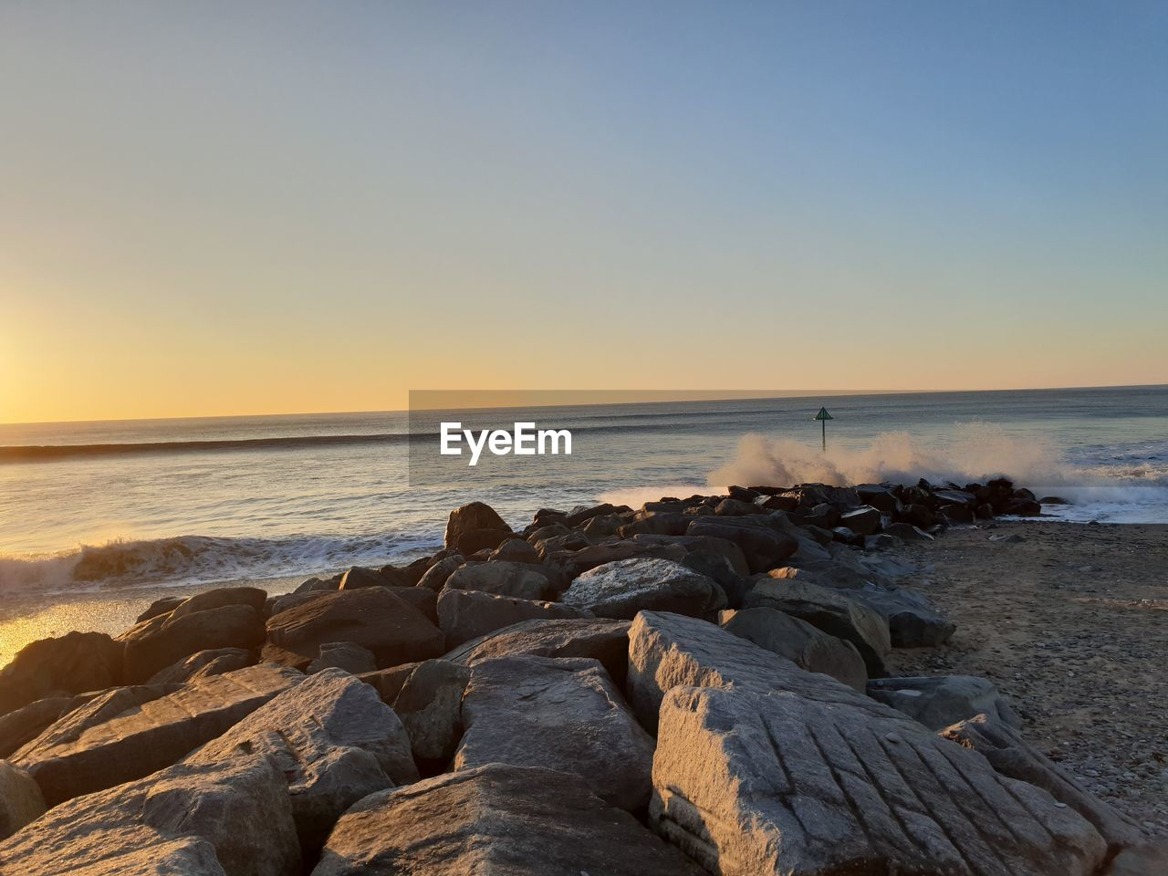 sea, water, sky, beach, land, horizon over water, scenics - nature, horizon, rock, beauty in nature, rock - object, sunset, solid, tranquility, tranquil scene, nature, motion, wave, clear sky, no people, outdoors, rocky coastline