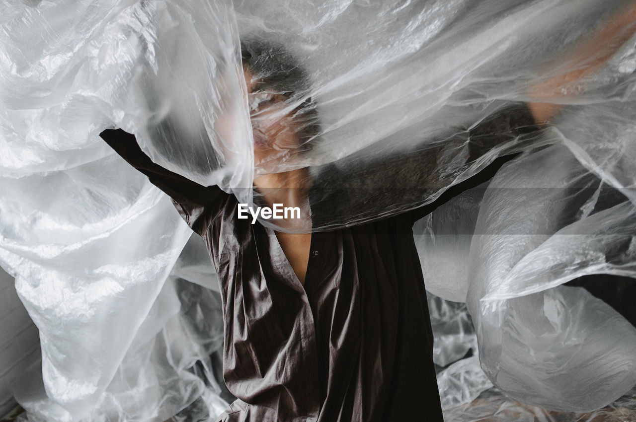 real people, one person, veil, sheet, young women, women, indoors, day, young adult, close-up, people