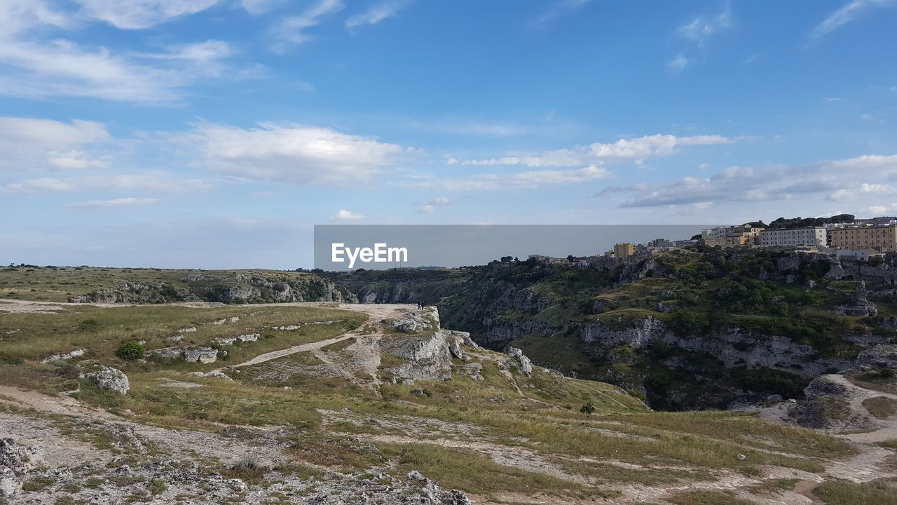 sky, cloud - sky, environment, architecture, landscape, built structure, nature, building exterior, scenics - nature, day, no people, tranquil scene, beauty in nature, land, tranquility, history, mountain, outdoors, non-urban scene, building, quarry