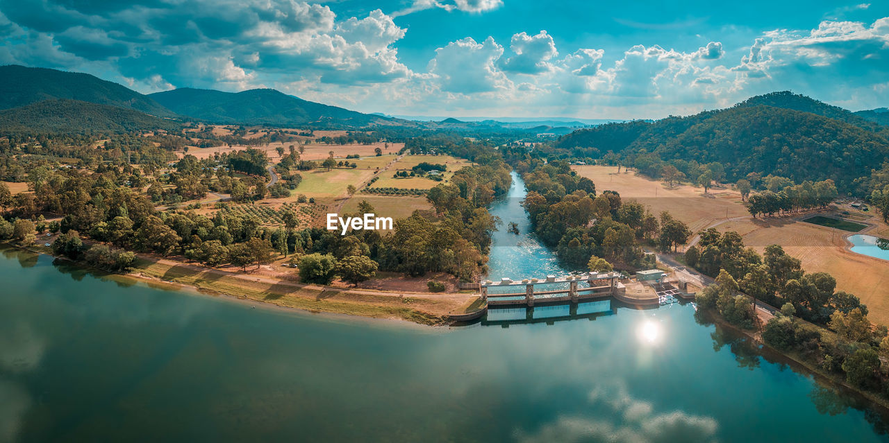 High Angle View Of Lake Eildon And Landscape Against Cloudy Sky