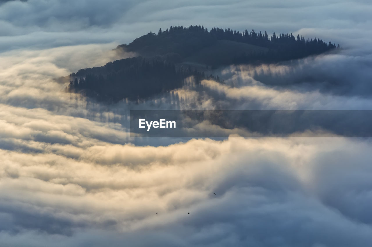 Aerial view of clouds and mountain