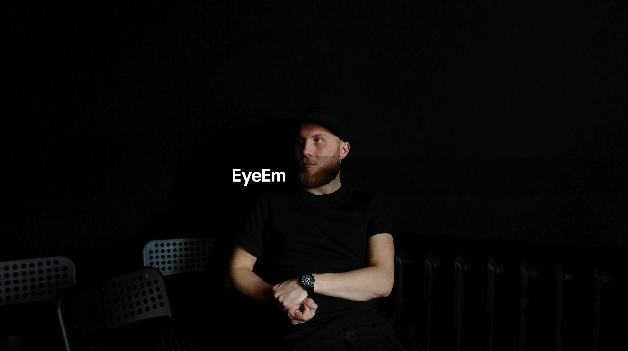 Young Man In Darkroom