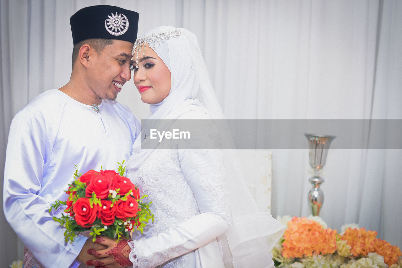 two people, couple - relationship, love, togetherness, women, flower, adult, emotion, celebration, real people, positive emotion, heterosexual couple, young women, flowering plant, plant, young adult, bonding, event, lifestyles, young men, bouquet, flower arrangement