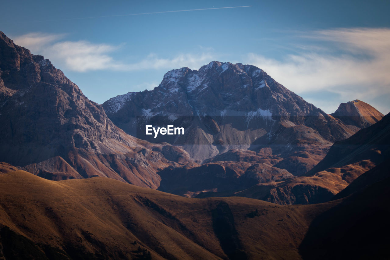scenics - nature, sky, mountain, beauty in nature, tranquil scene, tranquility, landscape, mountain range, environment, cloud - sky, non-urban scene, idyllic, nature, no people, physical geography, remote, cold temperature, outdoors, geology, snowcapped mountain, mountain peak, formation, arid climate, climate, eroded
