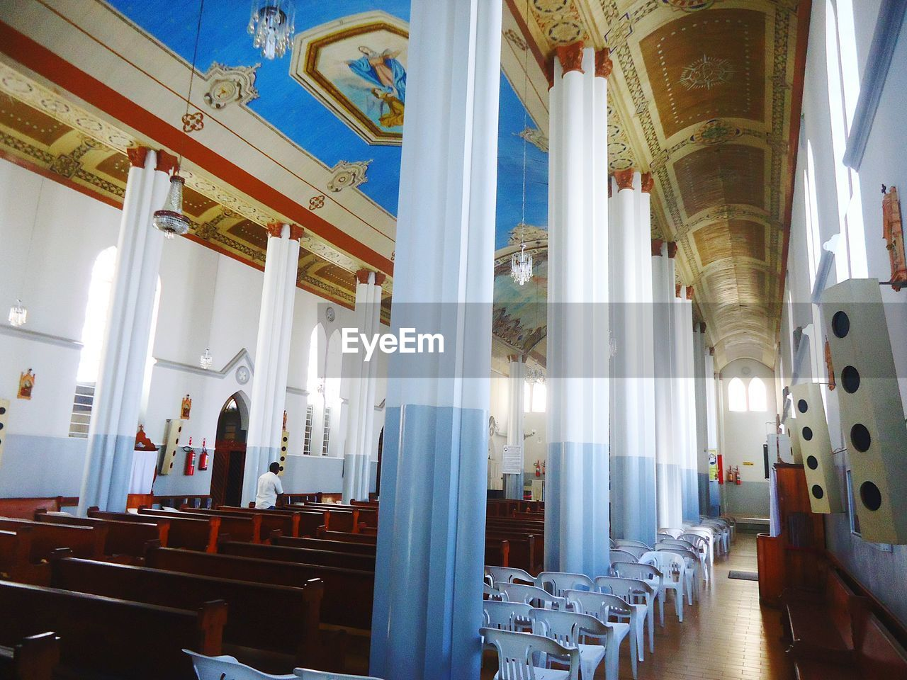 indoors, architectural column, religion, place of worship, in a row, spirituality, architecture, pew, history, chair, no people, day