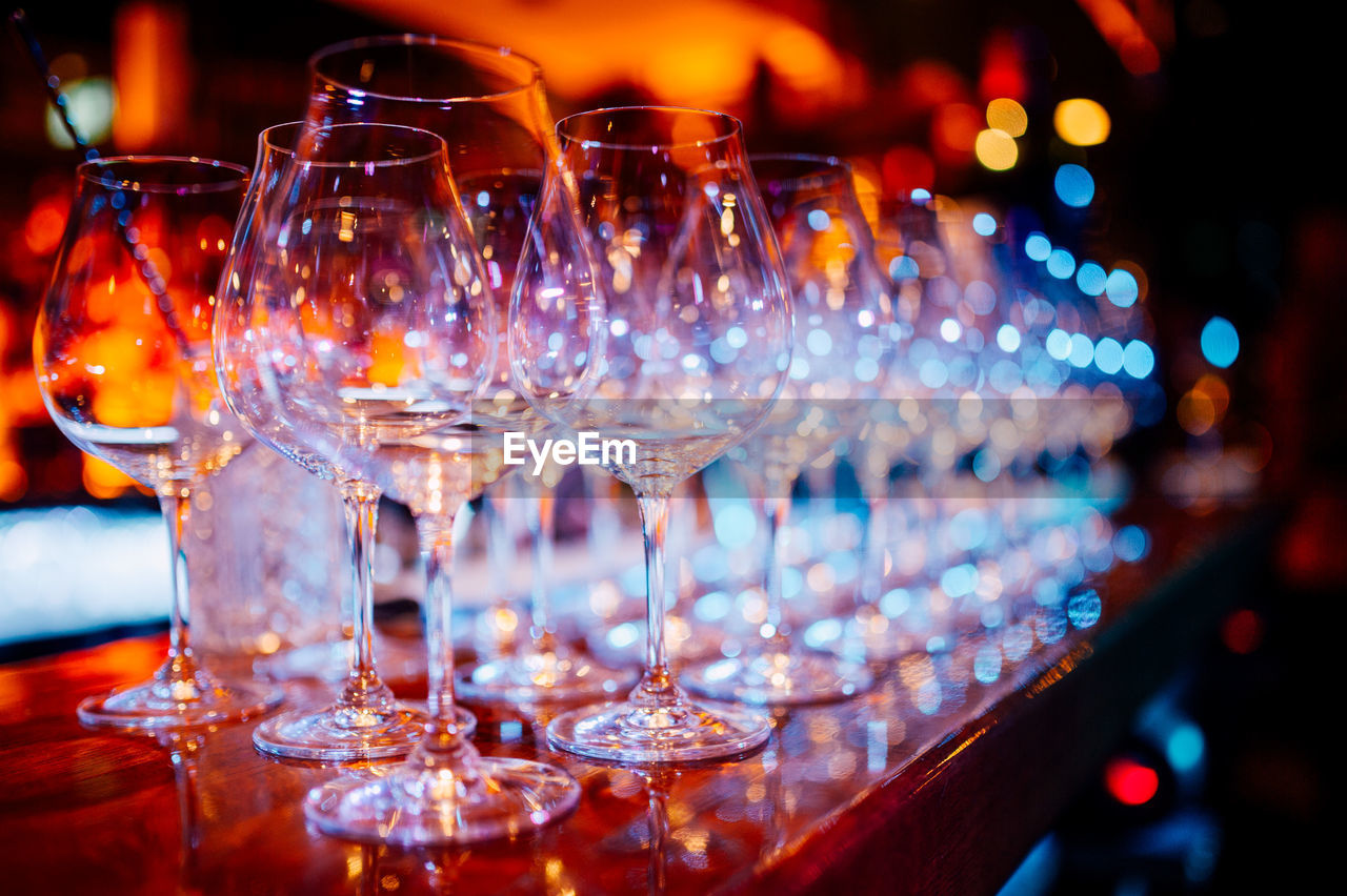 food and drink, alcohol, drink, refreshment, no people, illuminated, night, drinking glass, close-up, indoors, celebration, freshness