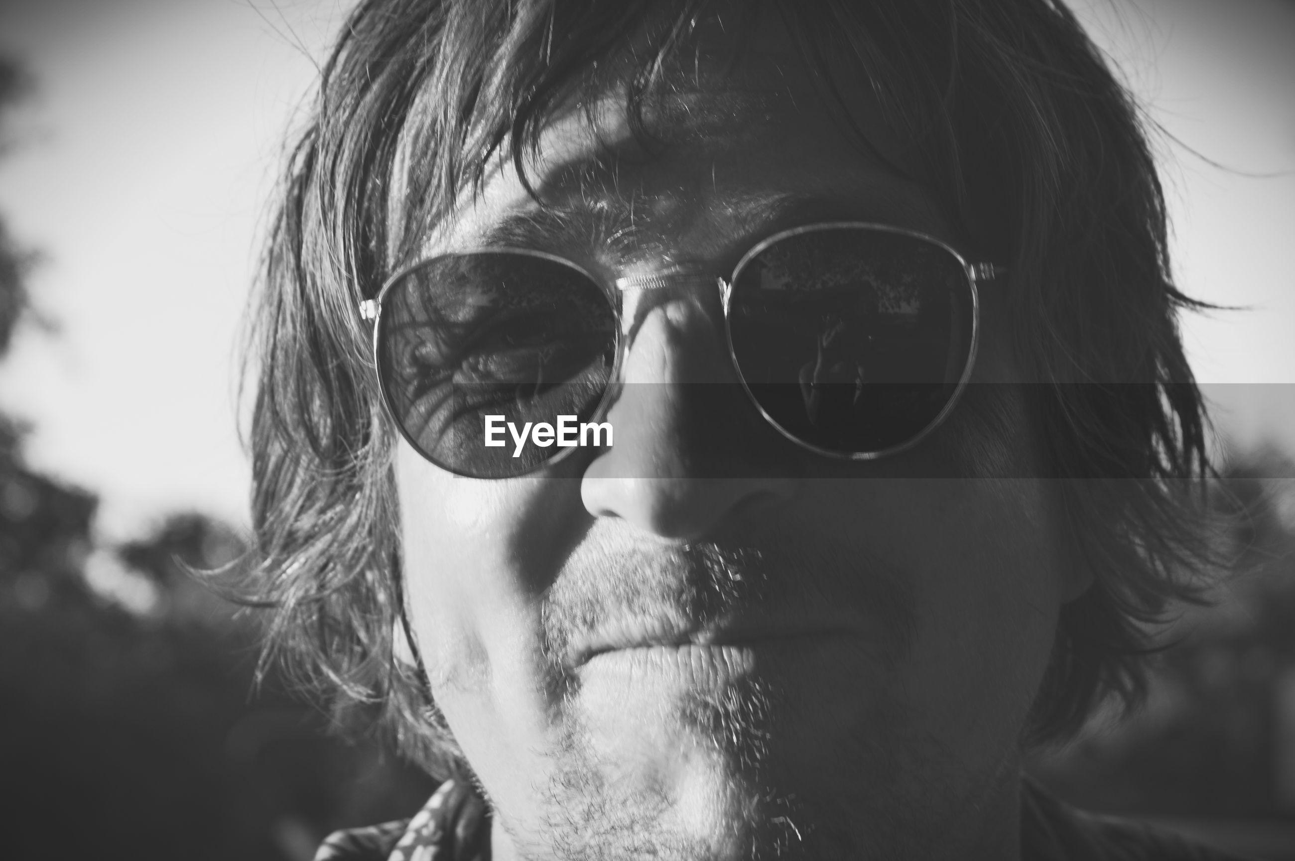 Close-up portrait of man wearing sunglasses