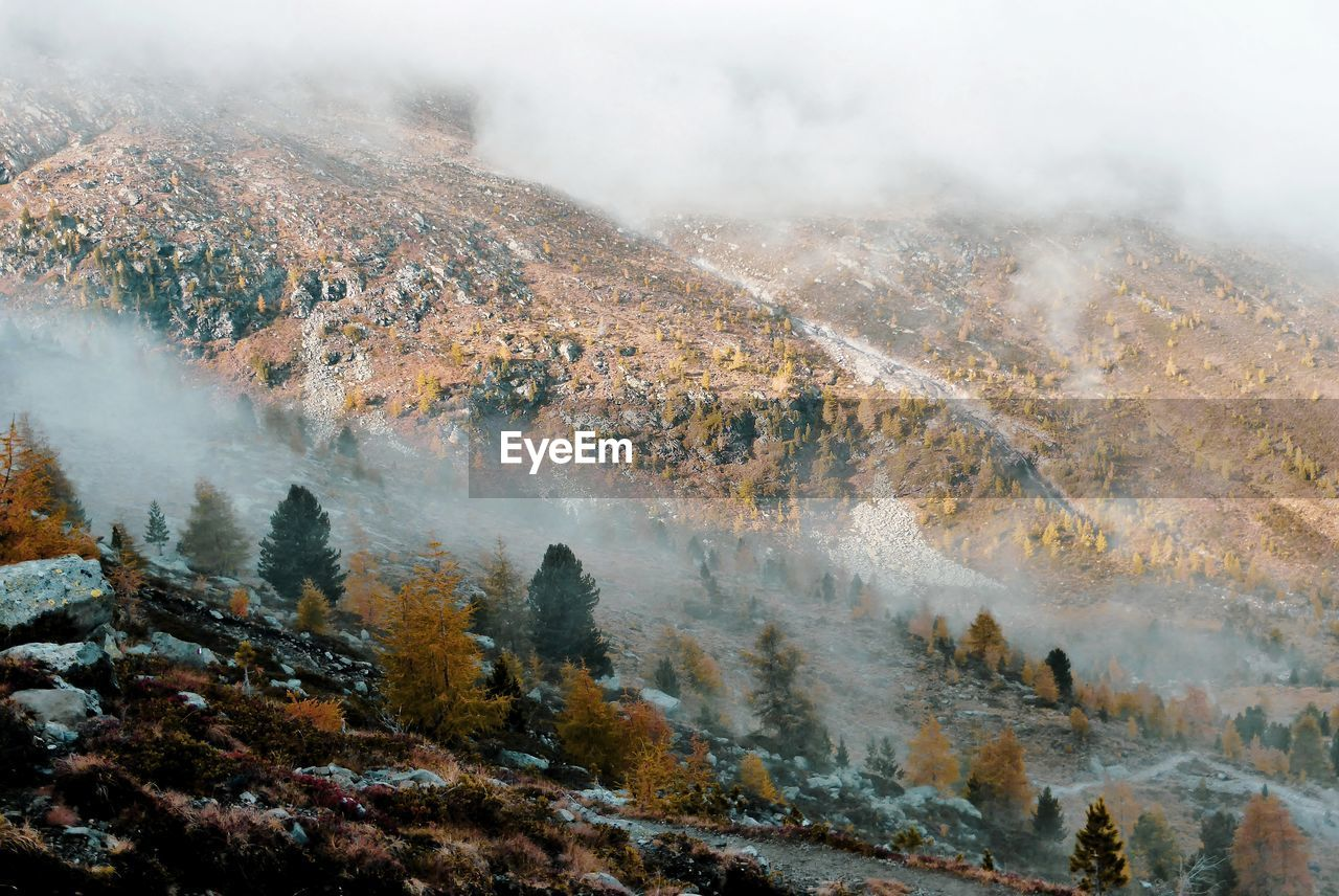 Aerial view of landscape during foggy weather
