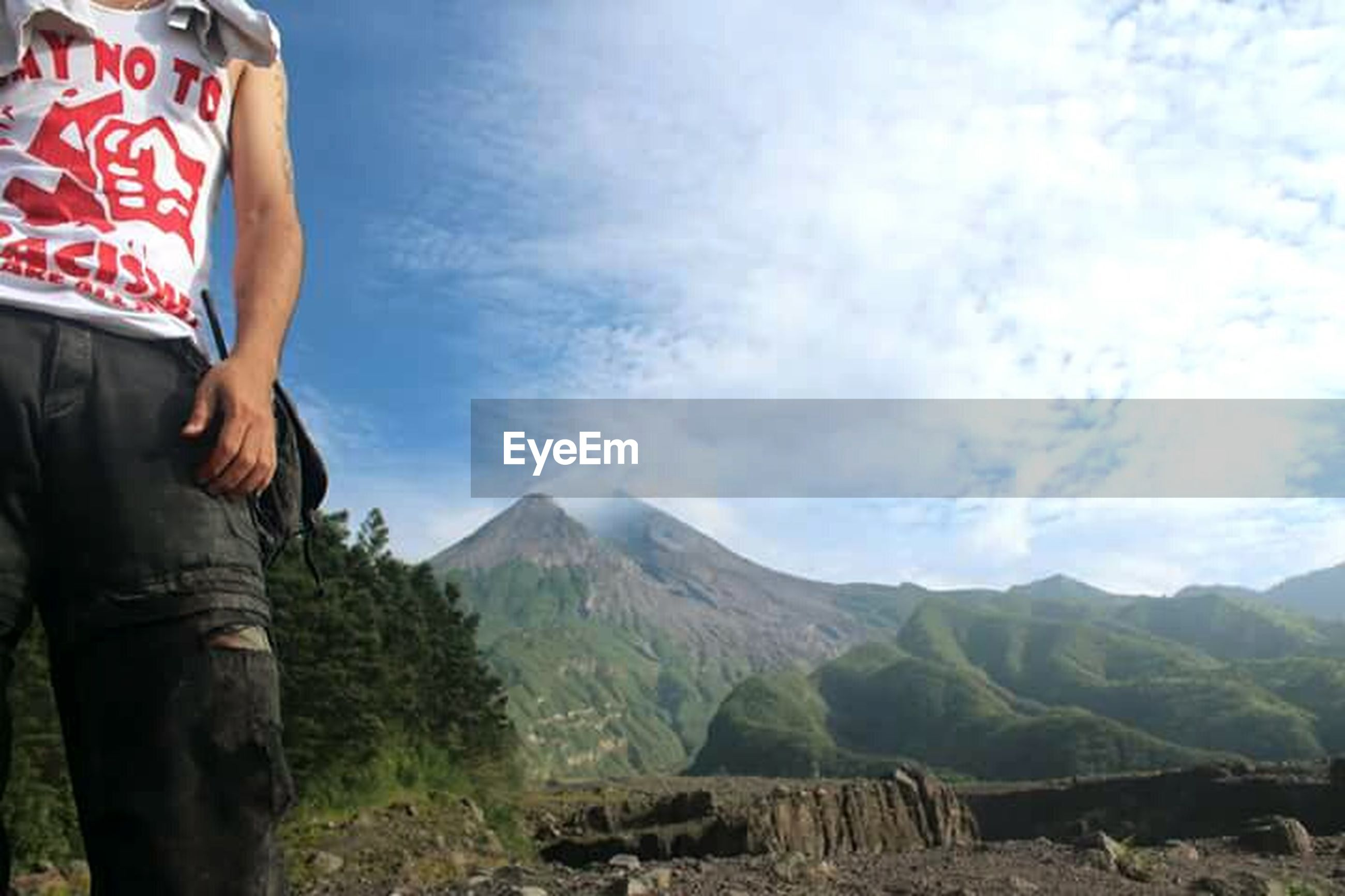 mountain, sky, lifestyles, leisure activity, landscape, mountain range, cloud - sky, casual clothing, standing, scenics, tranquil scene, tranquility, men, nature, cloud, beauty in nature, non-urban scene, person