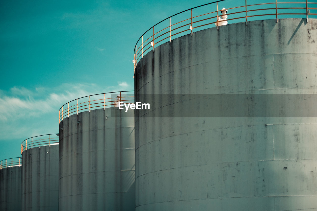 industry, factory, storage tank, architecture, silo, built structure, storage compartment, nature, container, sky, building exterior, fuel and power generation, low angle view, refinery, fuel storage tank, day, outdoors, no people, staircase, oil industry, industrial equipment, chemical plant