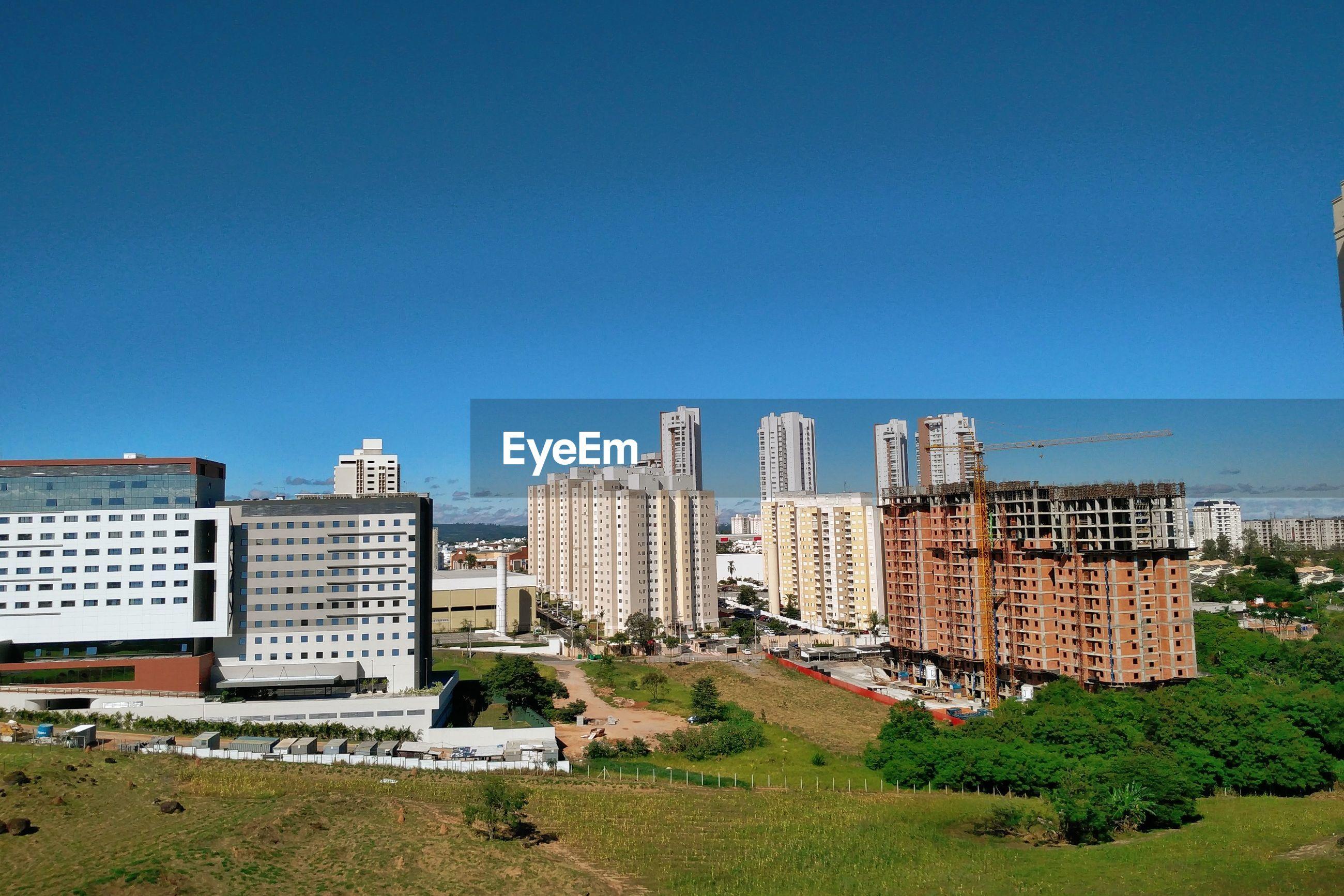 CITY AGAINST CLEAR BLUE SKY
