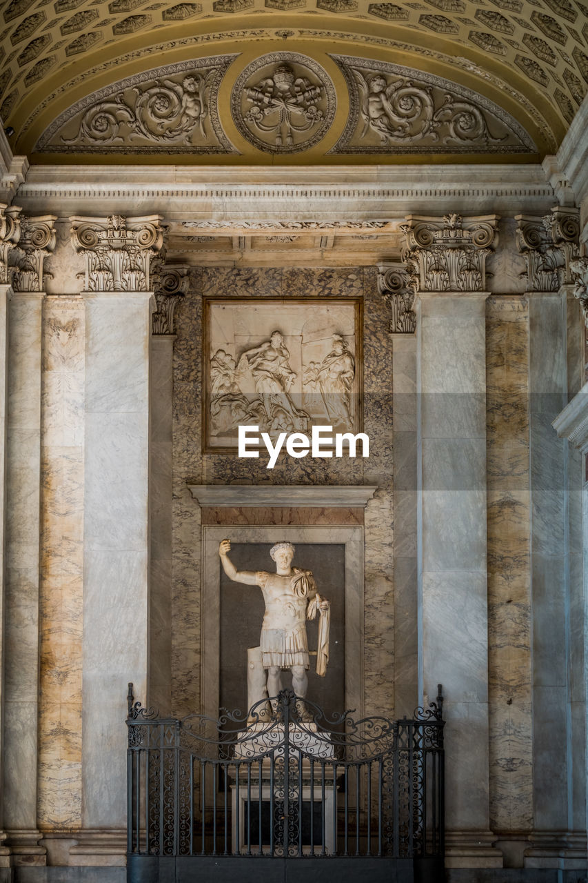 human representation, representation, art and craft, sculpture, statue, architecture, male likeness, built structure, history, the past, craft, creativity, building, no people, travel destinations, building exterior, religion, day, belief, city, architectural column, ornate, carving