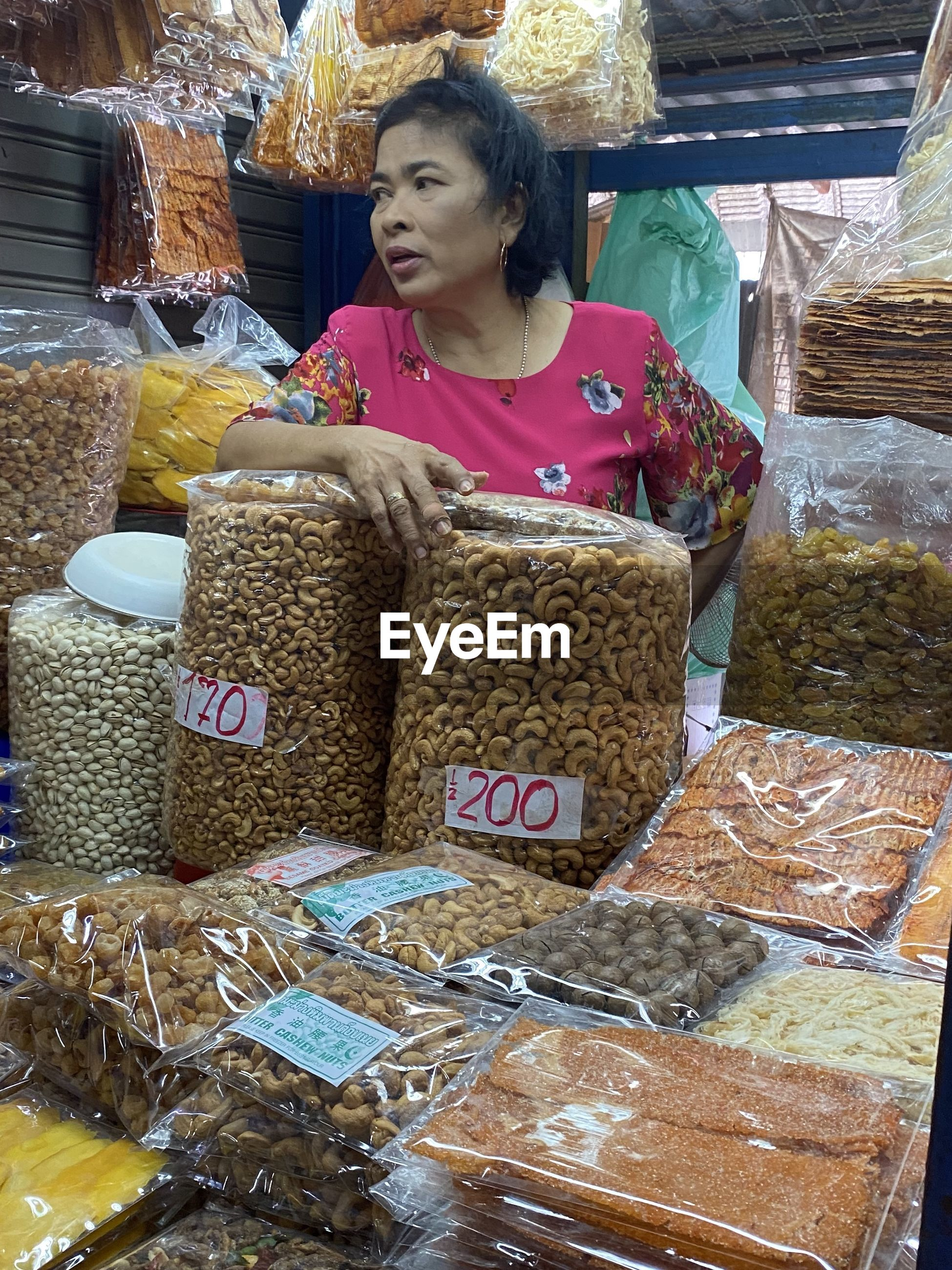 FULL LENGTH OF WOMAN IN MARKET STALL