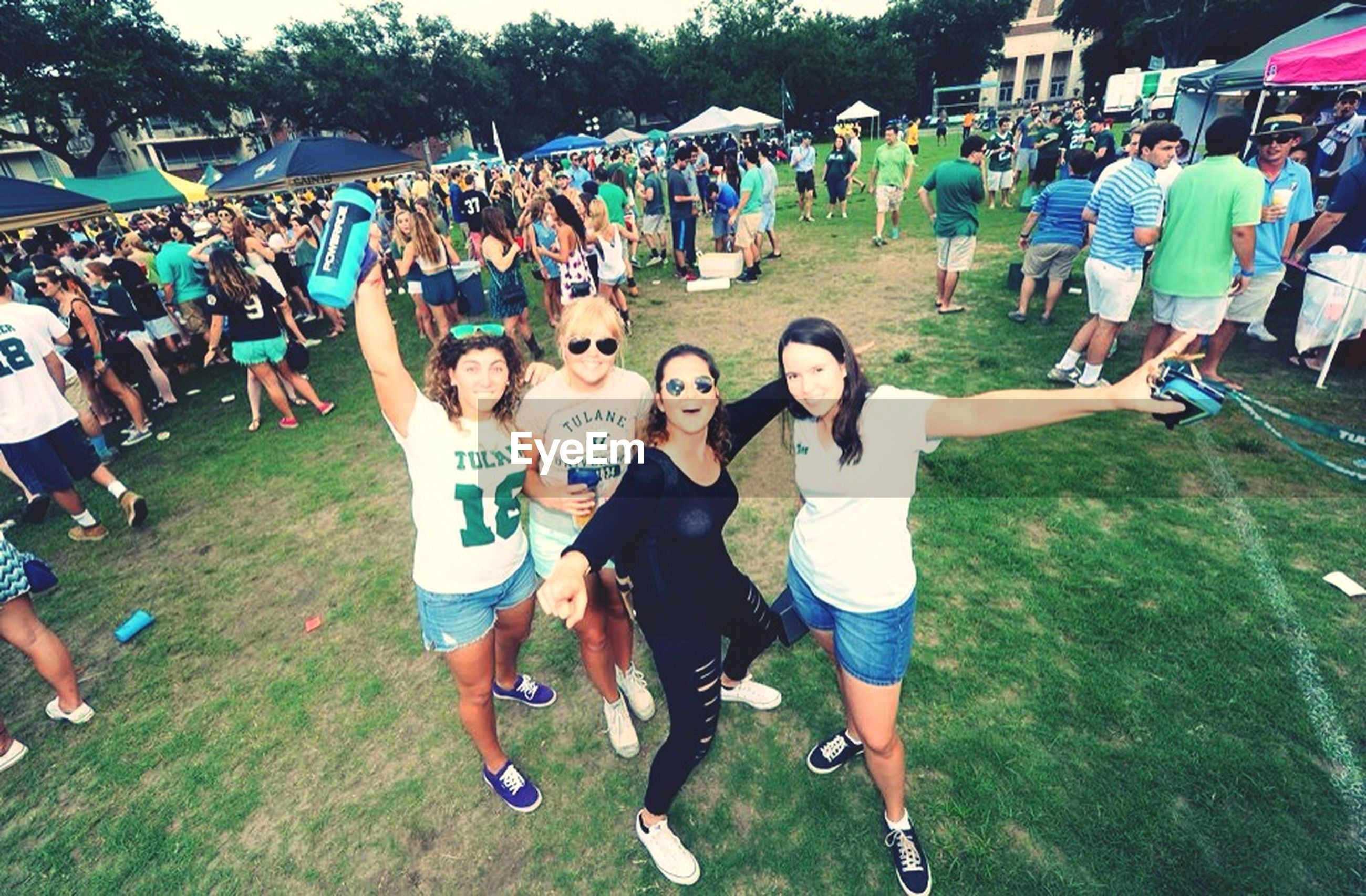 large group of people, lifestyles, leisure activity, person, men, casual clothing, enjoyment, togetherness, mixed age range, fun, happiness, standing, crowd, vacations, day, grass, full length, high angle view, outdoors