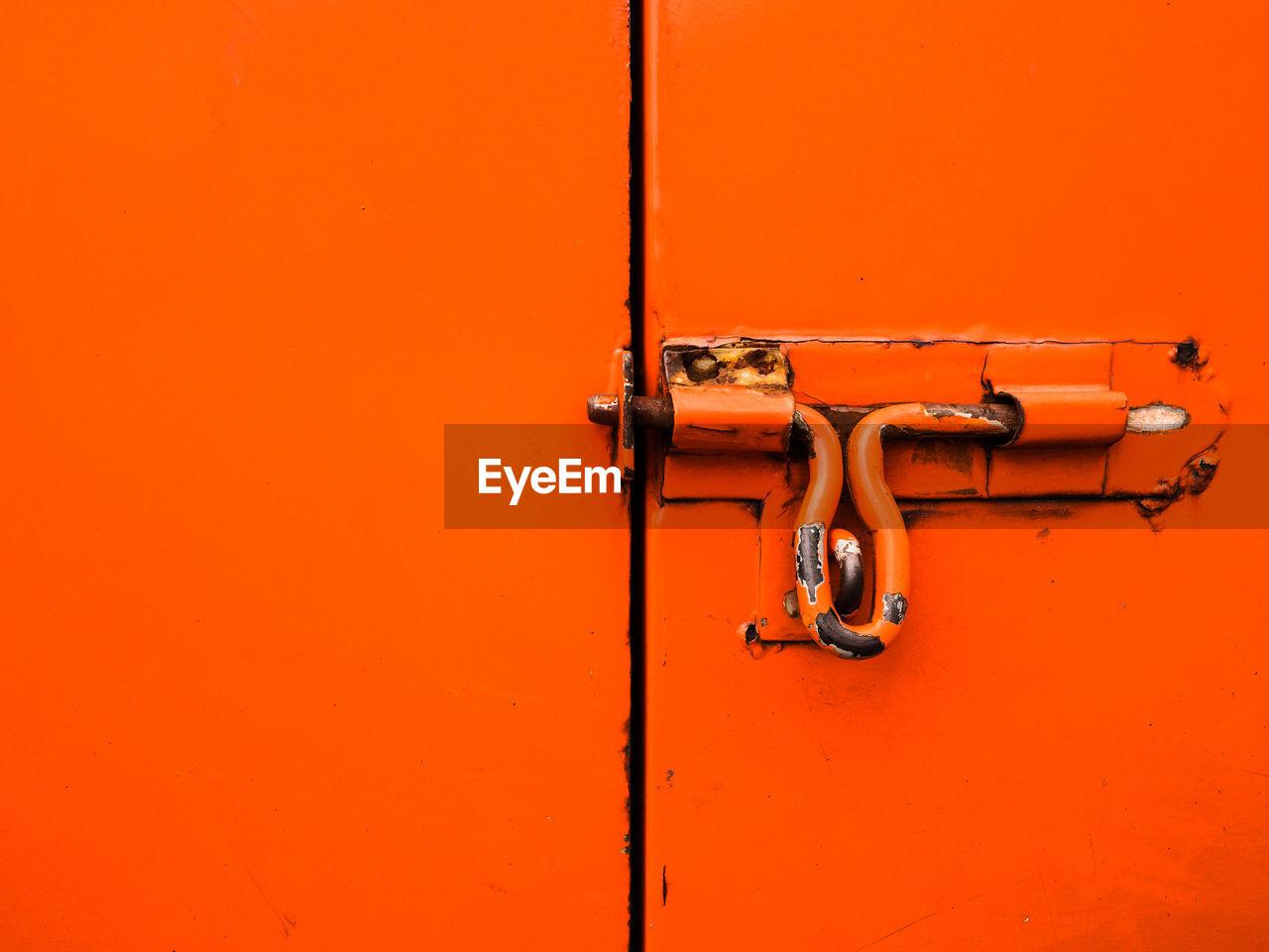 Close-Up Of Latch On Orange Door