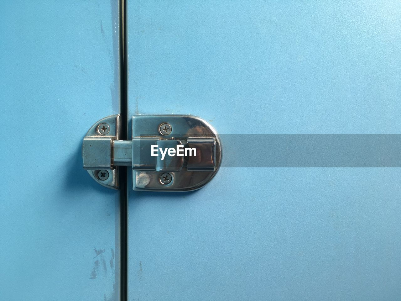 Close-Up Of Metallic Latch On Blue Door