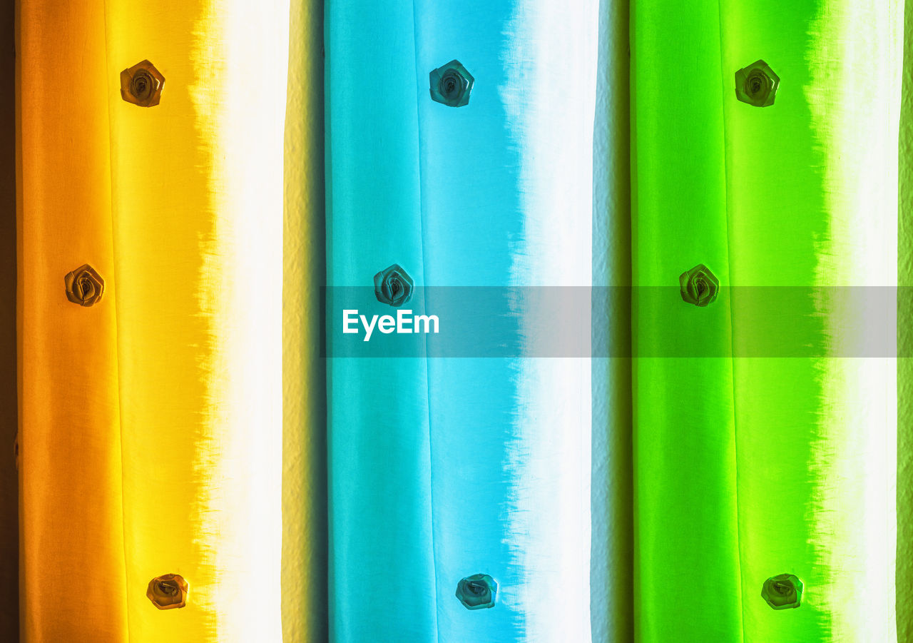 multi colored, full frame, close-up, yellow, no people, backgrounds, green color, day, vibrant color, door, entrance, choice, security, indoors, safety, variation, geometric shape, in a row, wall - building feature, turquoise colored