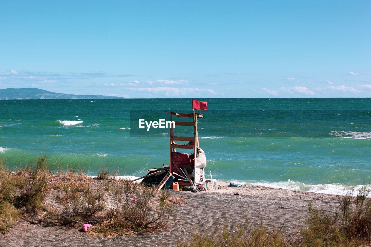 water, sea, sky, horizon, scenics - nature, beach, horizon over water, land, nature, beauty in nature, day, no people, tranquil scene, tranquility, flag, non-urban scene, blue, idyllic, cloud - sky, outdoors