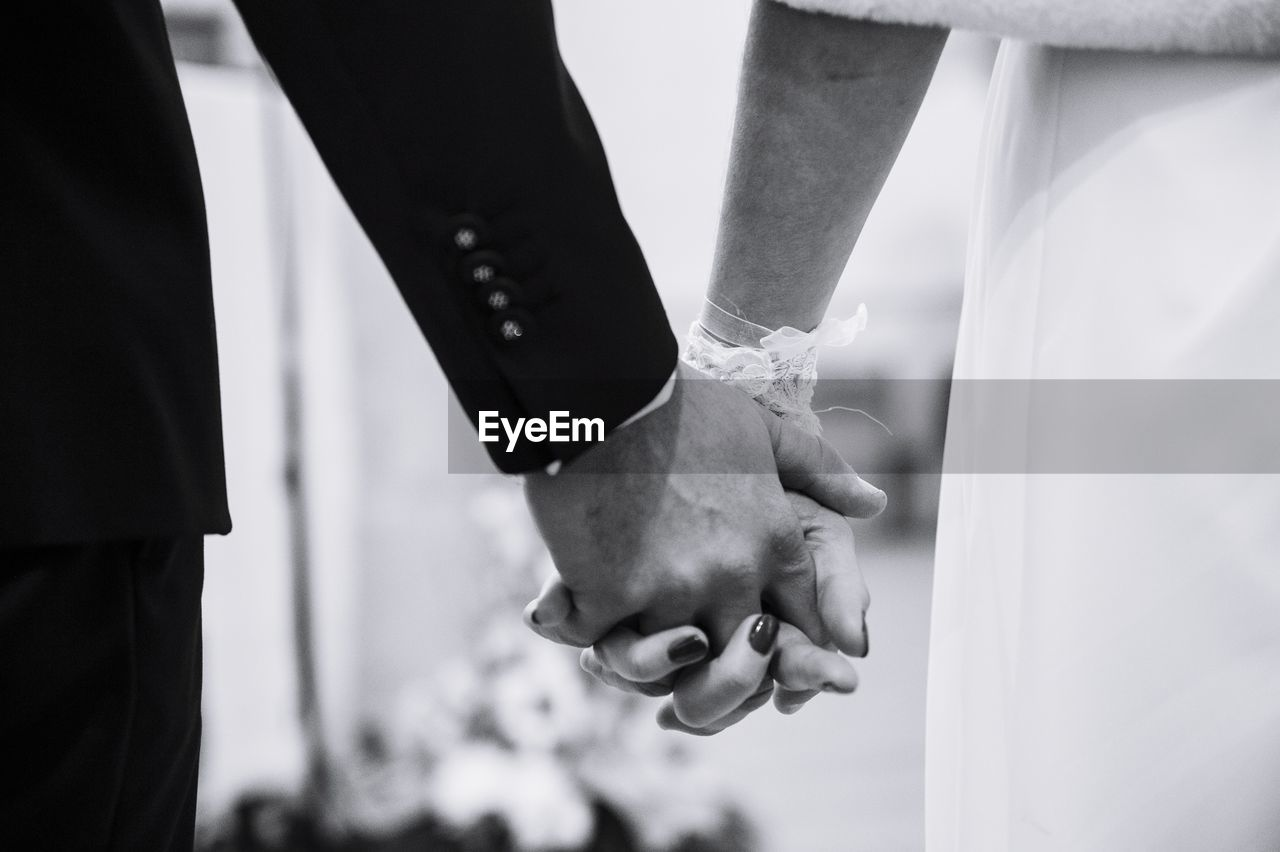 hand, human hand, wedding, couple - relationship, real people, celebration, love, two people, bride, newlywed, men, focus on foreground, human body part, women, event, adult, married, bonding, togetherness, people, positive emotion, wedding ceremony