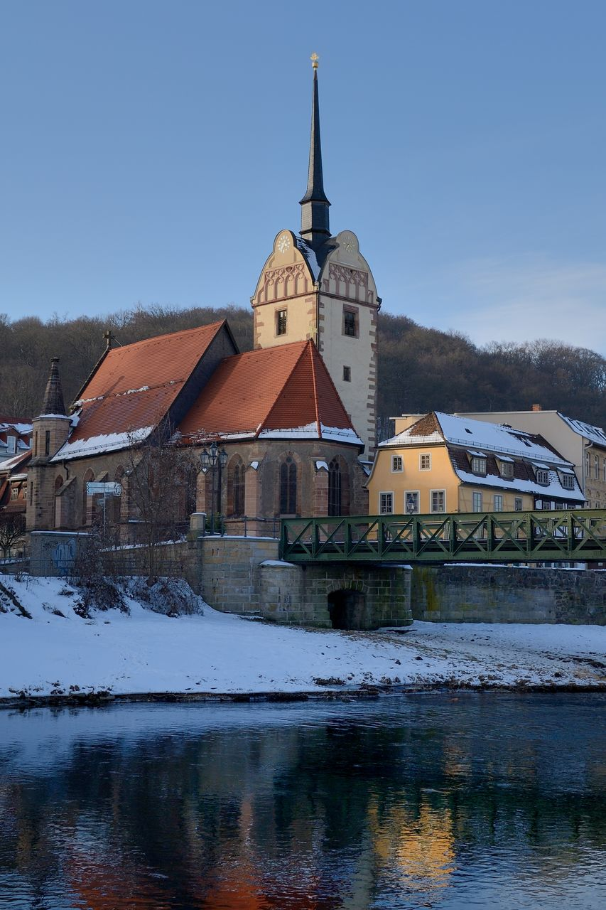 built structure, architecture, building exterior, building, sky, cold temperature, water, snow, winter, no people, nature, waterfront, reflection, religion, spirituality, belief, place of worship, river, outdoors, spire