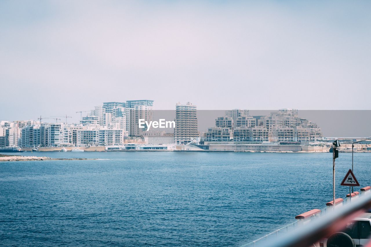 water, architecture, building exterior, built structure, city, sky, sea, waterfront, building, nature, nautical vessel, transportation, no people, outdoors, cityscape, day, mode of transportation, urban skyline, office building exterior, skyscraper, cruise ship