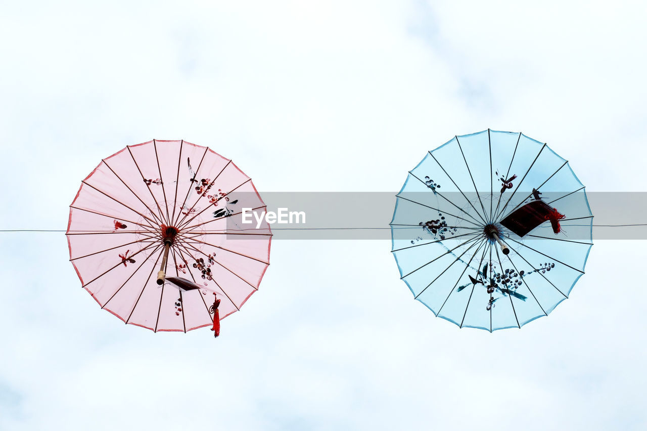 sky, low angle view, day, cloud - sky, geometric shape, circle, nature, shape, no people, outdoors, pattern, arts culture and entertainment, transportation, sport, design, ferris wheel, built structure, architecture, mid-air, adventure, directly below