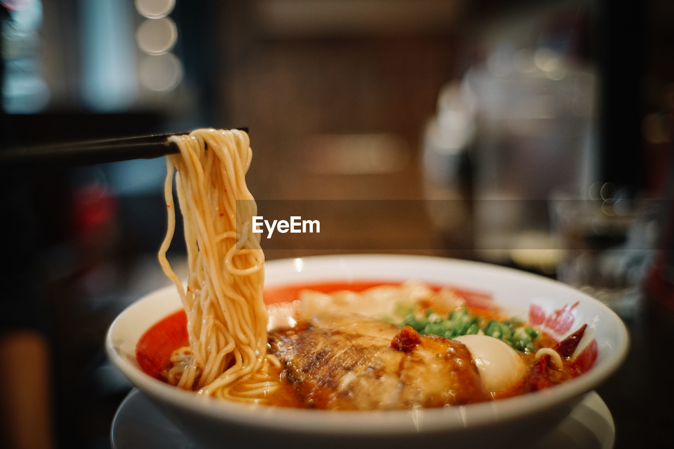 Close-up of spaghetti and meat served in bowl on table