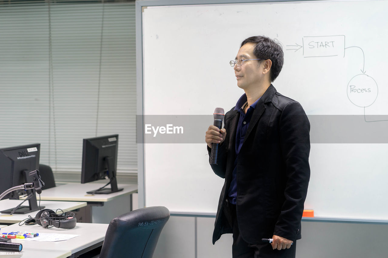Businessman Giving Presentation In Office
