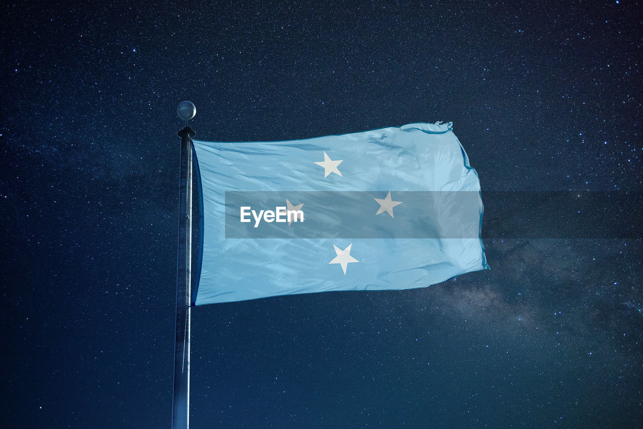 Low Angle View Of Micronesian Flag Against Star Field Sky