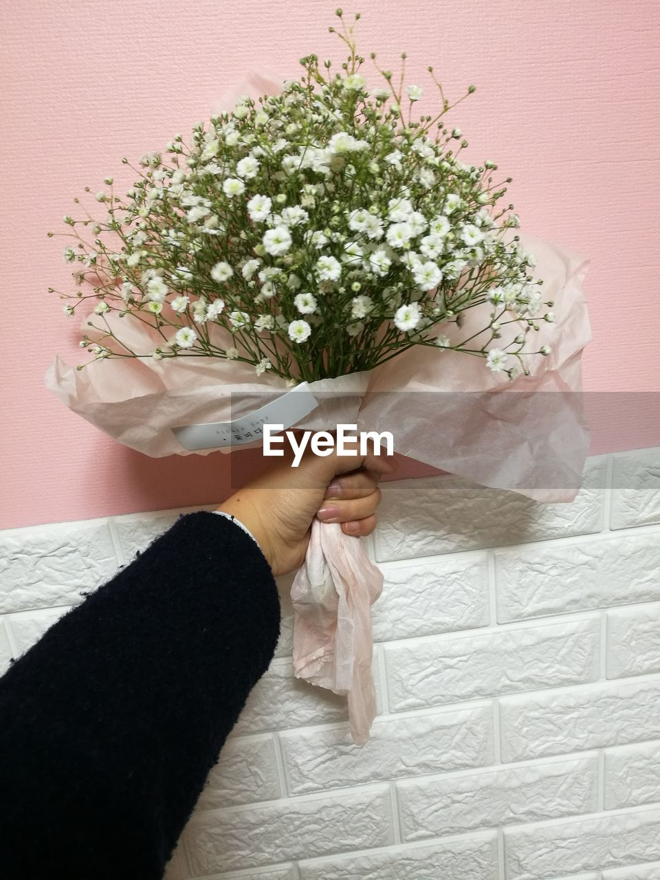 human hand, flower, wedding, bride, holding, celebration, human body part, life events, wedding dress, bouquet, one person, real people, indoors, wedding ceremony, women, lifestyles, close-up, low section, day, bridegroom, freshness, people