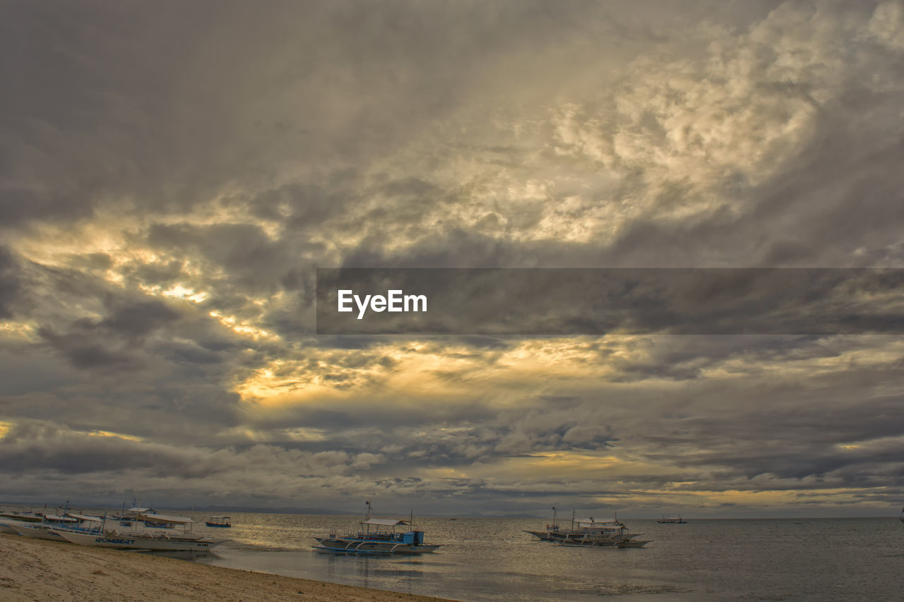cloud - sky, sky, nautical vessel, water, sea, sunset, scenics, transportation, beauty in nature, nature, horizon over water, mode of transport, tranquility, outdoors, no people, storm cloud, day
