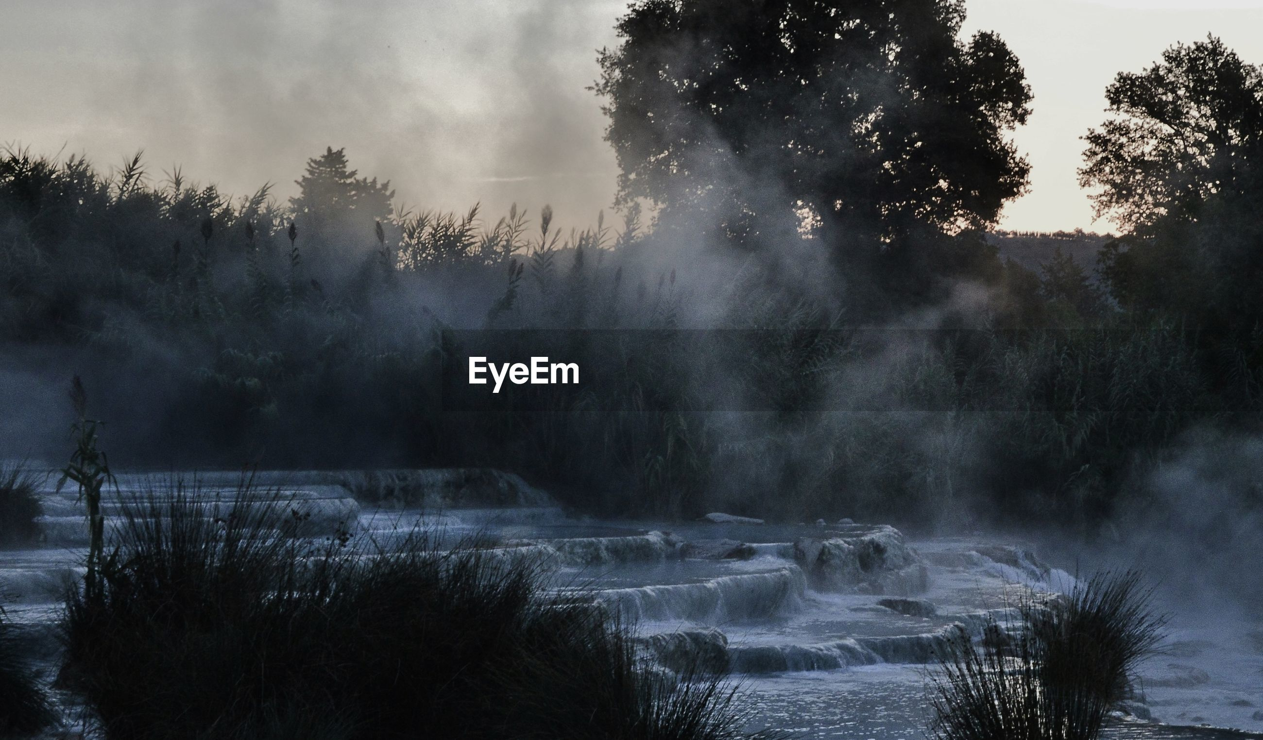 Scenic view of steam emitting for geyser