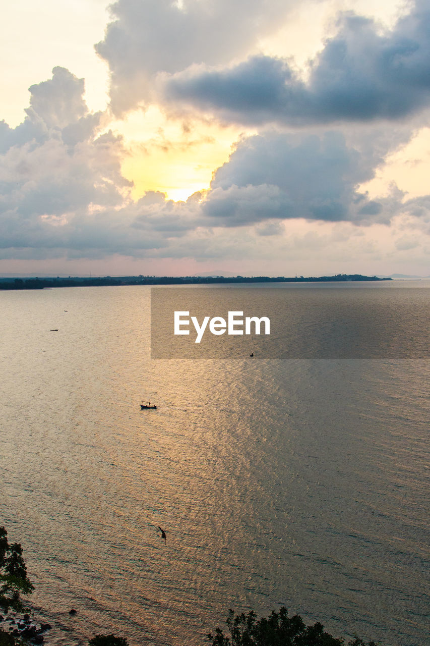 water, sunset, nature, tranquility, tranquil scene, sky, scenics, sea, cloud - sky, beauty in nature, no people, outdoors, beach, sand, horizon over water, day, bird