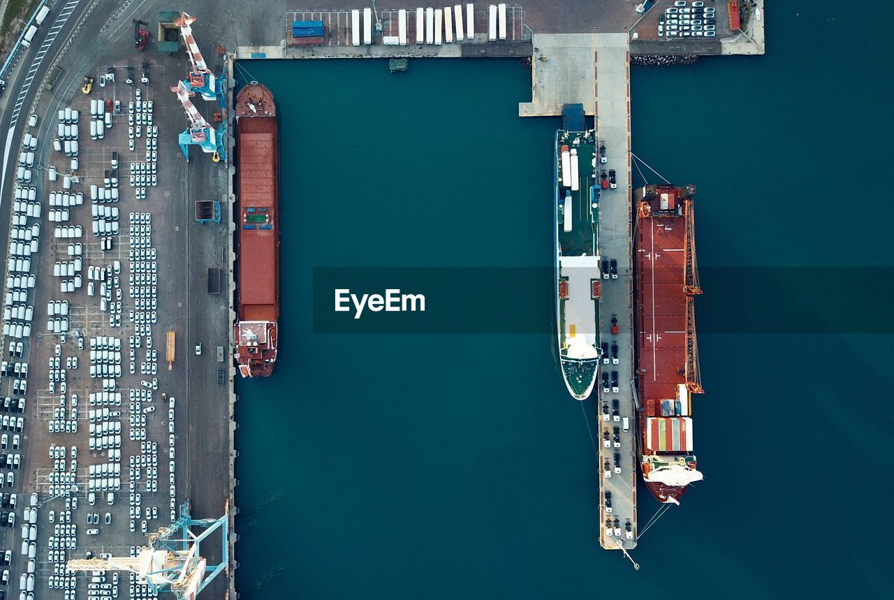 mode of transportation, transportation, high angle view, architecture, freight transportation, nautical vessel, water, shipping, no people, pier, waterfront, business, harbor, moored, nature, day, directly above, commercial dock, building exterior, outdoors, canal, bay