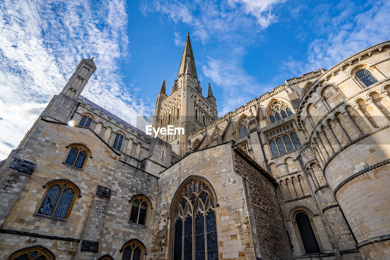 built structure, building exterior, architecture, place of worship, low angle view, belief, religion, spirituality, sky, building, travel destinations, cloud - sky, day, nature, the past, history, no people, arch, outdoors, spire, gothic style