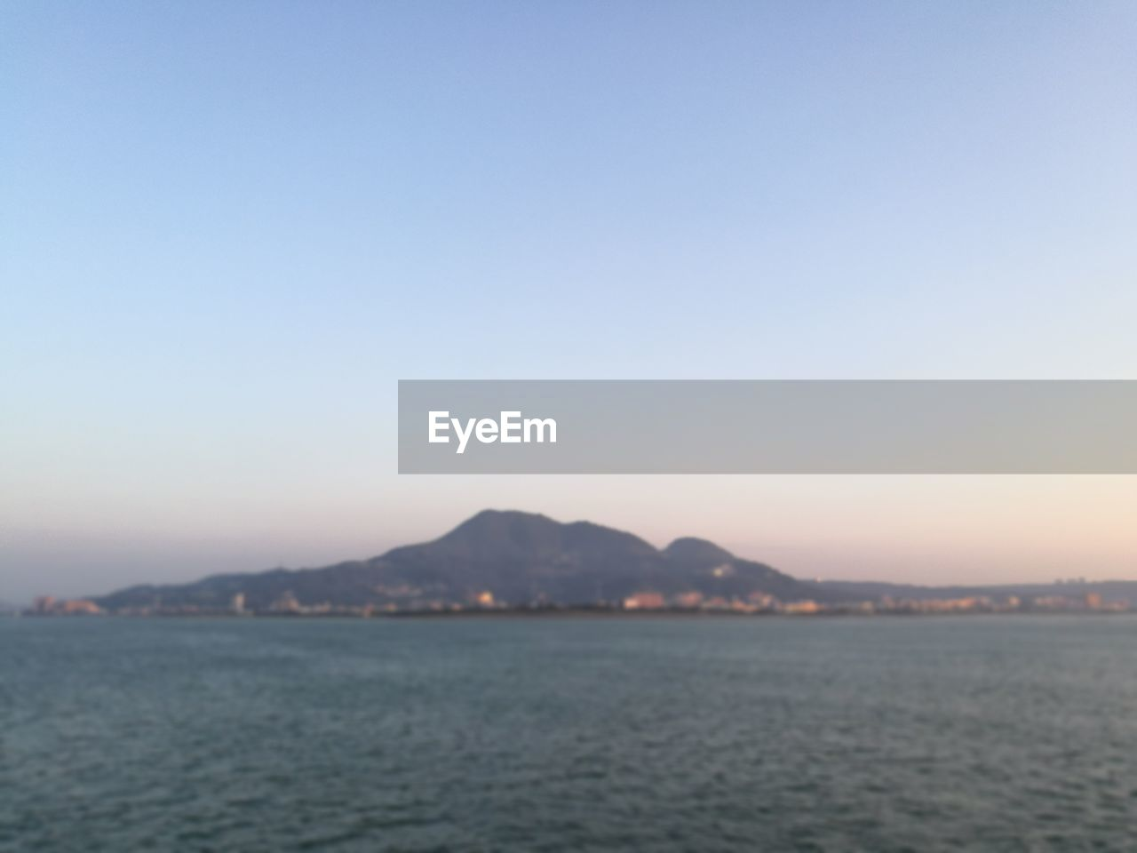 copy space, nature, clear sky, tranquility, beauty in nature, water, mountain, waterfront, no people, tranquil scene, outdoors, sunset, scenics, sea, view into land, sky, day
