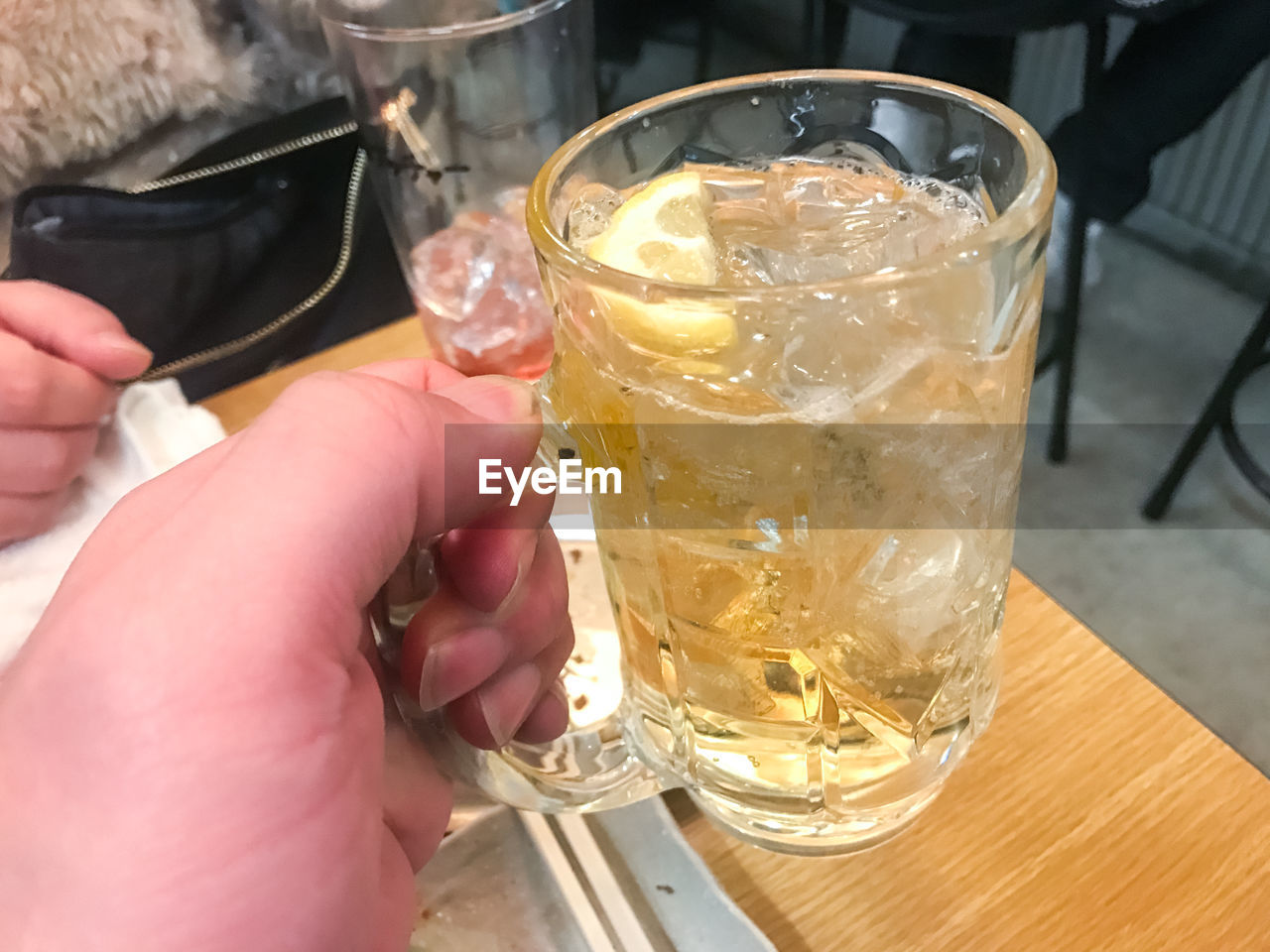 human hand, drinking glass, real people, food and drink, drink, one person, refreshment, human body part, holding, table, freshness, leisure activity, day, alcohol, close-up, lifestyles, indoors, men, people