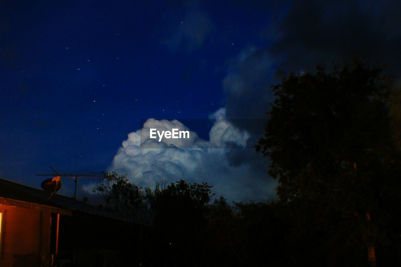 sky, night, low angle view, tree, cloud - sky, silhouette, nature, no people, outdoors, beauty in nature, star - space, scenics, astronomy, illuminated, architecture, space, galaxy