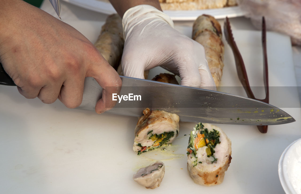 Midsection Of Chef Slicing Food