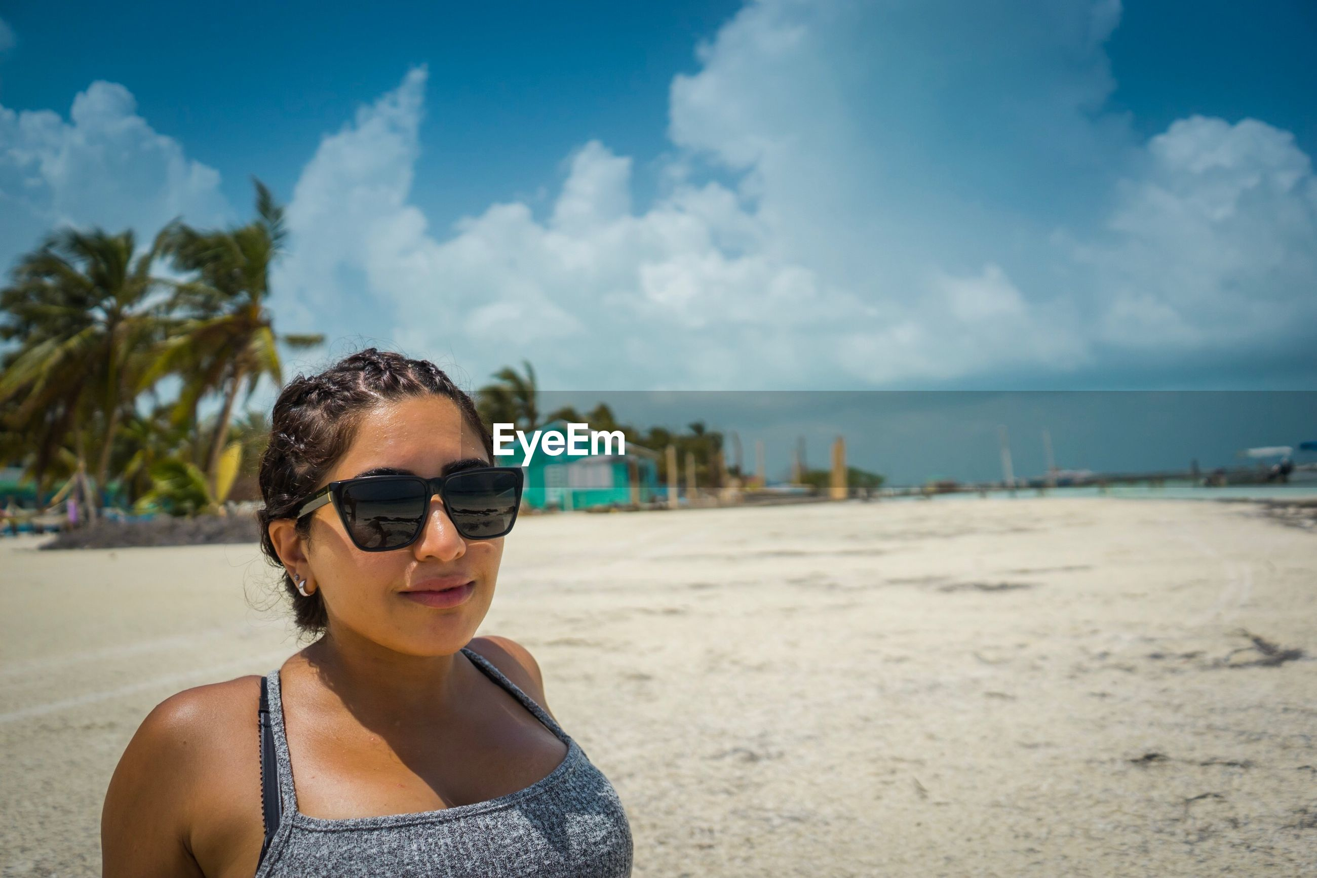 Woman wearing sunglasses at beach during summer