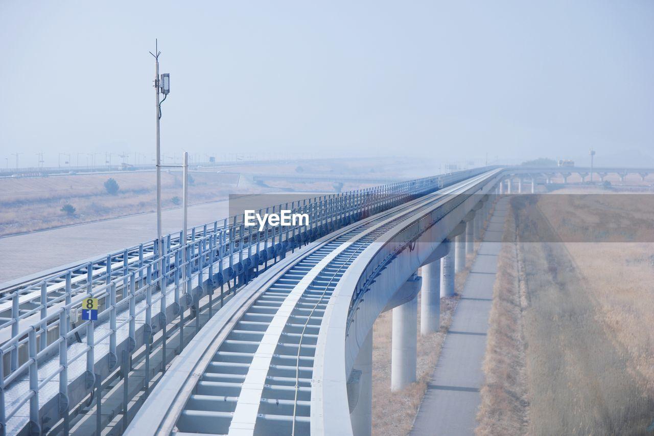Road By Bridge Against Clear Sky