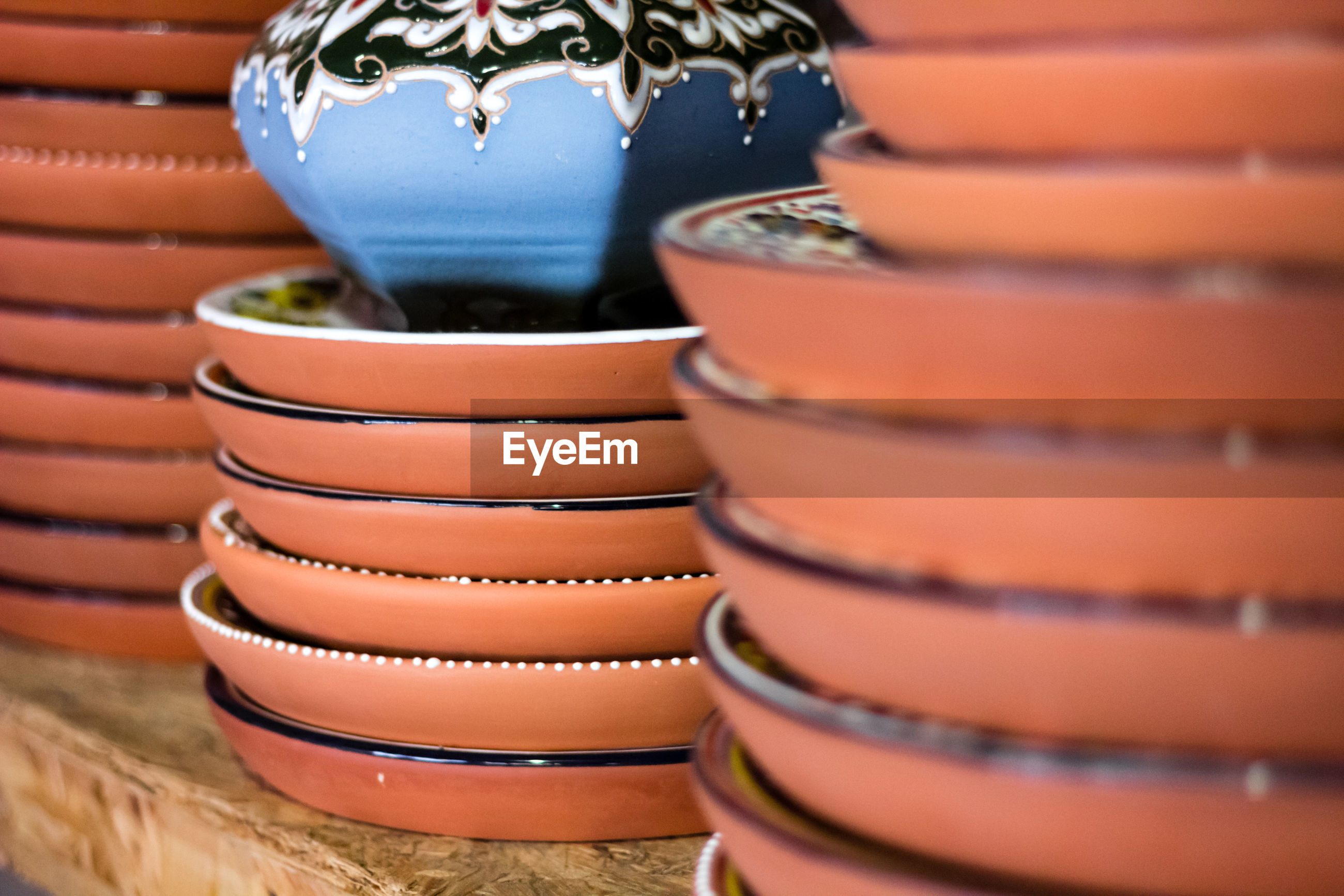Close-up of stacked plates at market stall