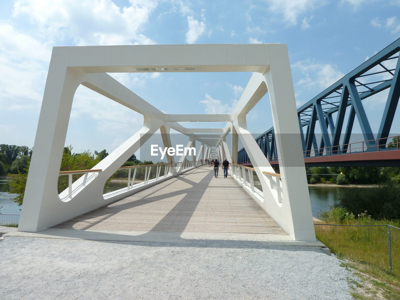 built structure, architecture, bridge, connection, bridge - man made structure, sky, nature, transportation, day, direction, cloud - sky, the way forward, engineering, outdoors, diminishing perspective, sunlight, footbridge, travel destinations, metal, architectural column