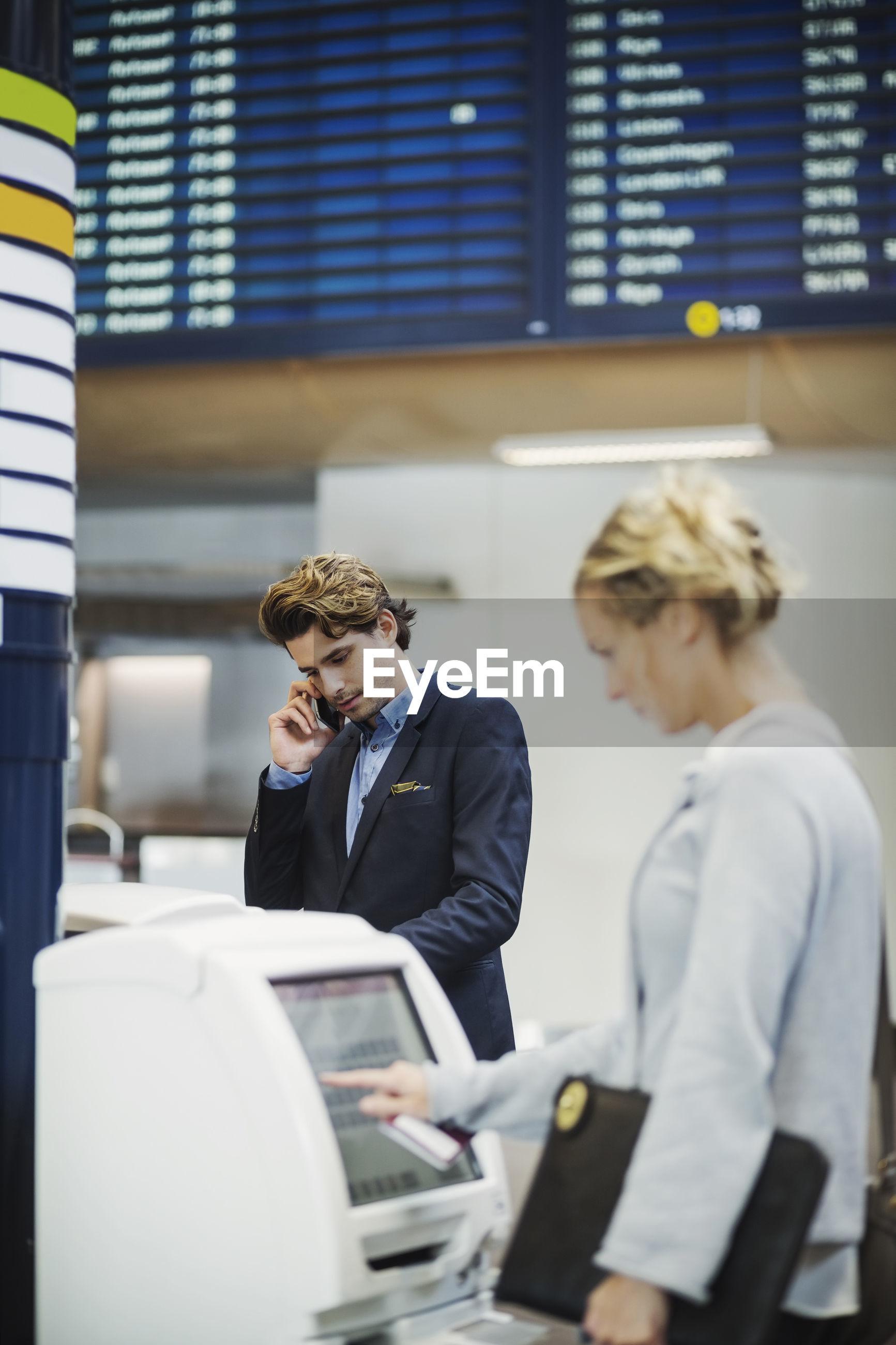PEOPLE LOOKING AT SMART PHONE